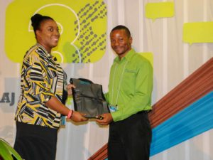 Solomon Perkins, Development Manager at Epic Technologies collects gift at HRMAJ Conference 38 after doing presentation on HR Integration Systems